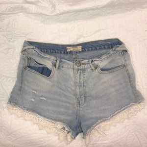 Free People jean shorts with lace on bottom